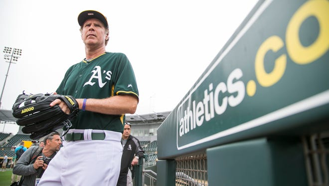 Will Ferrell leaves the Athletics' dugout on his way to the field before a game against the Mariners at Hohokam Stadium in Mesa, AZ on March 12, 2015.