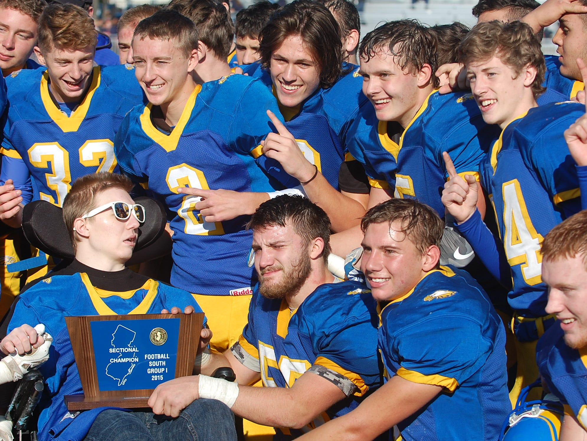 With teammate Kyle Pszenny front and center, Pennsville celebrates winning the South Jersey Group 1 title.