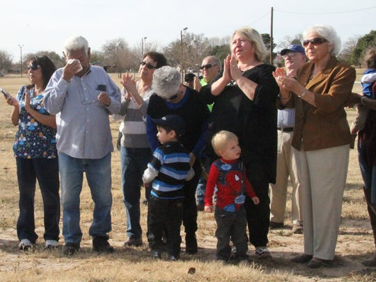 Many members of the Salcido family wiped away tears on Thursday as the the Nick Salcido Sr. Dark Canyon Crossing sign was unveiled to honor the late City Councilor.