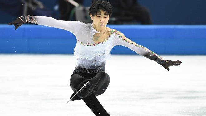 Yuzuru Hanyu competes during the free skate of men's figure skating at the Iceberg Skating Palace during the Sochi 2014 Olympic Winter Games.