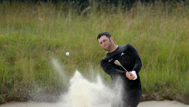 Jun 11, 2018; Southampton, NY, USA; Jon Rahm hits from a bunker onto the 16th green during Monday's practice round of the 118th U.S. Open golf tournament at Shinnecock Hills.
