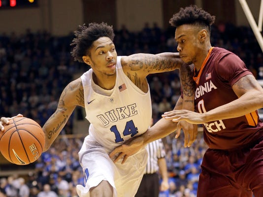 FILE - In this Jan. 9, 2016, file photo, Duke's Brandon Ingram (14) dribbles the ball as Virginia Tech's Shane Henry (0) defends during the first half of an NCAA college basketball game in Durham, N.C. Ben Simmons and Brandon Ingram look to be the first two picks in the NBA draft, leaving most of the drama Thursday night around who be the No. 3 pick.  (AP Photo/Gerry Broome, File)