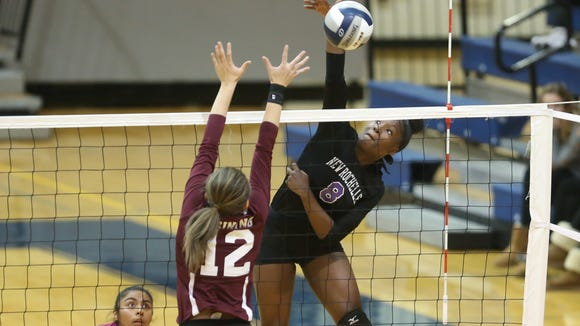 New Rochelle's Olivia Morgan (8) puts a shot over Ossining's