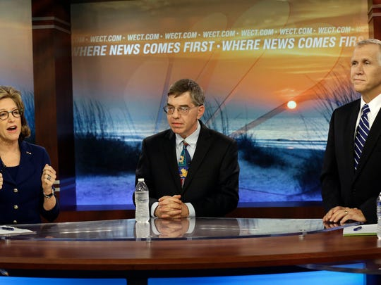 Sen. Kay Hagan, D-N.C., left, speaks as Libertarian Party Senate candidate Sean Haugh, center, and North Carolina Republican Senate candidate Thom Tillis listen during a Oct. 9, 2014, televised debate at WECT studios in Wilmington, N.C.