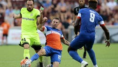 FC Cincinnati midfielder Corben Bone (19) slides for