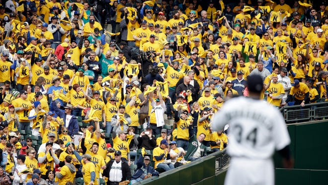 "Seattle Mariners' fans seated in the ""King's Court"" cheer starting pitcher Felix Hernandez (34) on his first strikeout, of Los Angeles Angels lead off hitter Kole Calhoun in the first inning of a baseball game Monday, April 6, 2015, in Seattle."