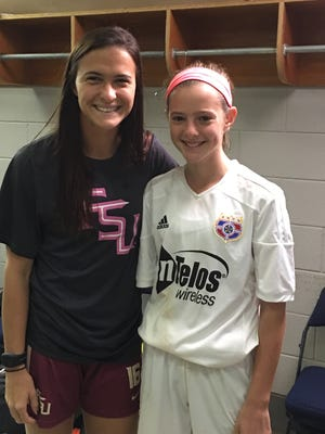 SOCA player Allison Quick (right) met former Florida State University soccer player Carson Pickett (left) before a UVA and Florida State game.
