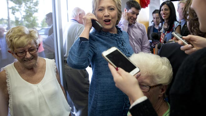 Democratic presidential candidate Hillary Clinton visits a Dunkin' Donuts in West Palm Beach, Fla., on Tuesday.