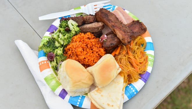 """A fiesta plate consisting of barbequed meats, red rice, pancit, dinner rolls, flour tatiyas, and salad was submitted in the """"May the forks be with you"""" Matapang Beach BBQ Contest during the Circle K Paddles Against Cancer 2016 """"Pac Wars"""" at Matapang Beach Park in Tumon on March 13."""