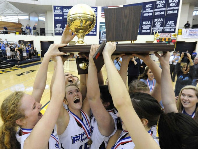 The PCS Lady Bobcats celebrate their MAIS basketball overall state championship after beating MRA, 44-34, in Clinton at the Mississippi College A.E. Wood Coliseum on Saturday.