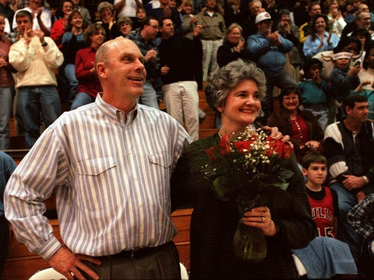 Lipscomb basketball coach Don Meyer and his wife, Carmen, receive praise after his 700th win at McQuiddy Gym.