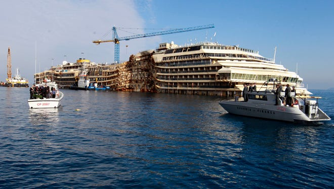 The shipwrecked Costa Concordia off the coast of Italy on Jan. 13, 2014.