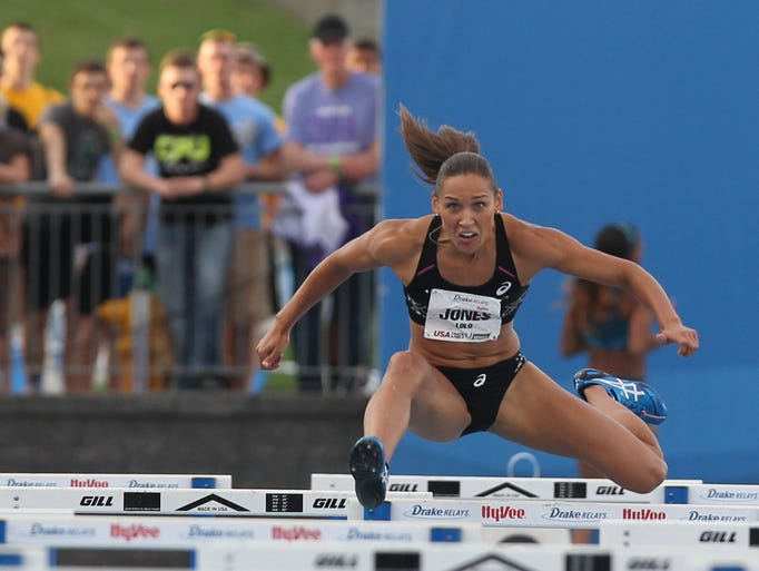USA Red team Lolo Jones competes in the Women 4x100 Meter Shuttle Hurdle Special during the Drake Relays at Drake Stadium in Des Moines, Iowa.