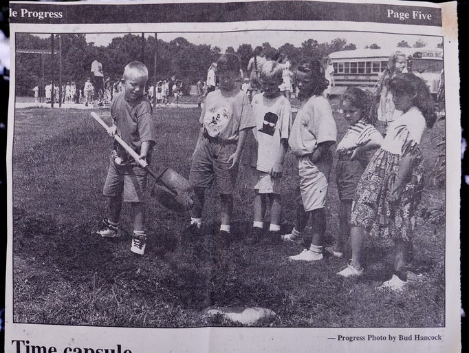 A clip from the October 1, 1994 edition of the Prattville Progress showing Prattville Elementary, third grade students burying a time capsule. Robbie Jacks, left, Lane Stewart, Justin Crawford, Sarah Mills-Stewart, Brittany Cook-Wiggins and Jodi Crowe.