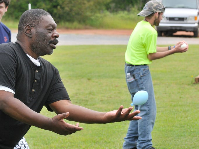 Herbert Crawford juggles a balloon during a toss game at the Smith Center's Field Day on Saturday, June 28, 2014, in Prattville, Ala..