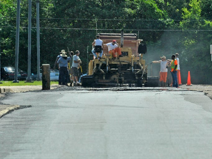 Paving has begun on the driving routes in the front parking lot of Prattville High School on Wednesday, July 30, 2014.