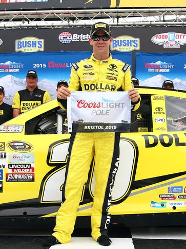 Matt Kenseth celebrates after winning  the pole for