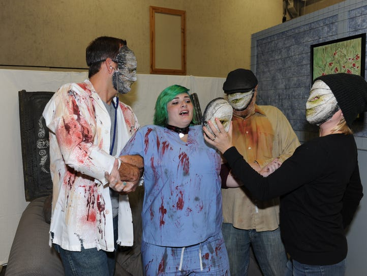 Volunteers work on a scene from Haunted SHAC before