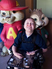 "Ryan Cottor, 14, shows off donated ""Chipmunks"" on the"