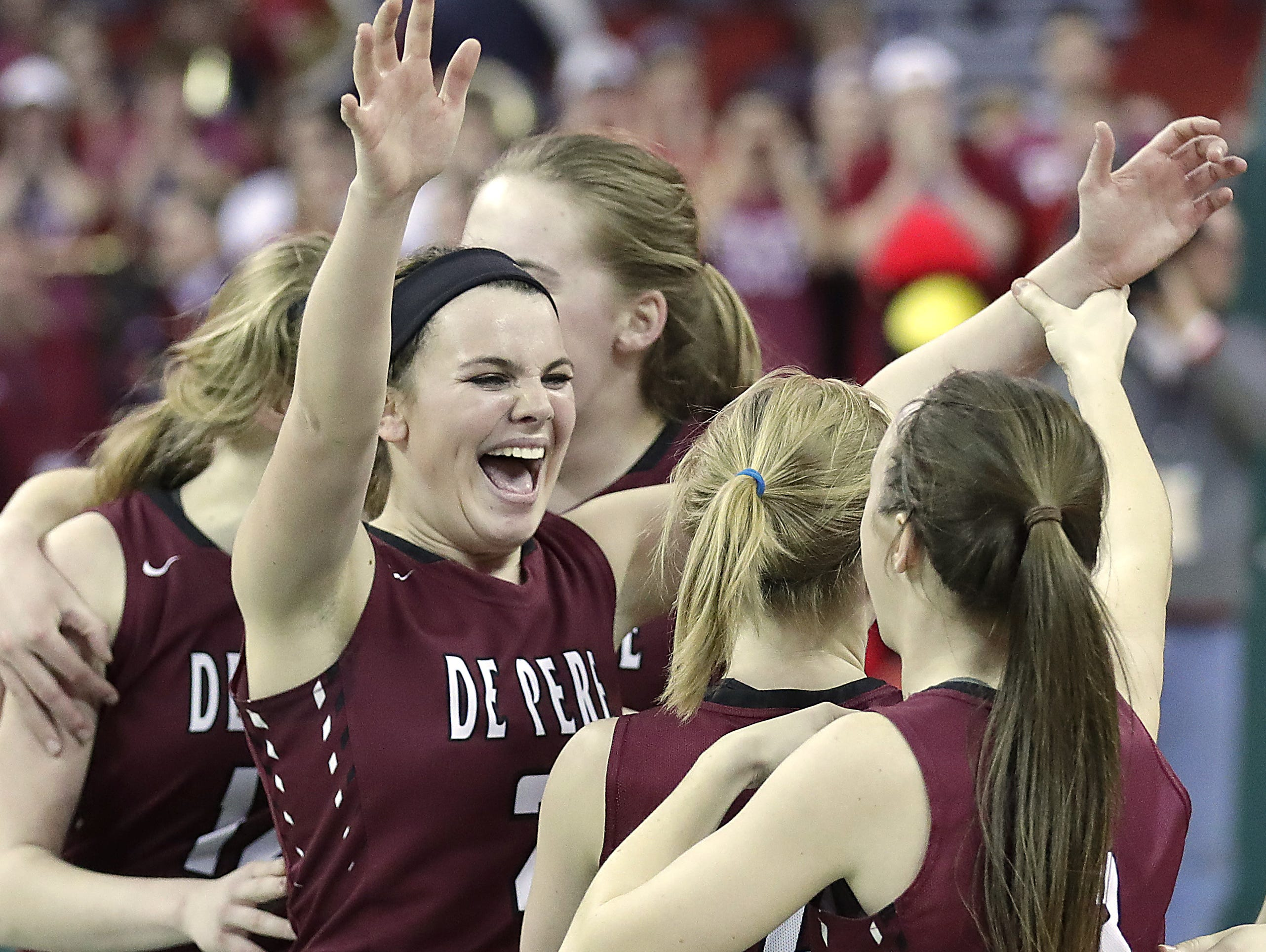 De Pere Annie Schneider cheers as the Redbirds win in overtime against Middleton in a WIAA Division 1 Girls State Basketball semifinal at the Resch Center in Ashwaubenon Friday.