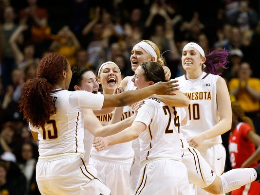 Minnesota basketball players celebrate their 90-88 victory against Ohio State in an NCAA college basketball game Wednesday, Feb. 24, 2016 in Minneapolis. (AP Photo/Stacy Bengs)