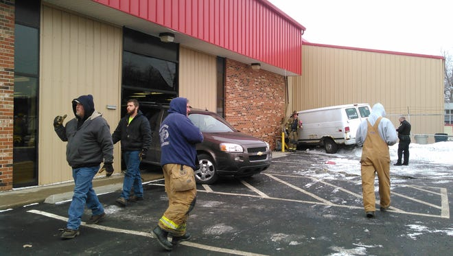 Two vehicles crashed into the H&D SupeRent building Tuesday morning.