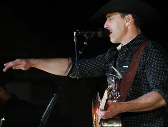 Aaron Watson acknowledges a fan during his 2018 concert at the Taylor County Coliseum.