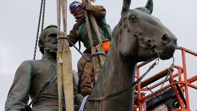 Work crews remove the statue of confederate general Stonewall Jackson, Wednesday, July 1, 2020, in Richmond, Va. Richmond Mayor Levar Stoney has ordered the immediate removal of all Confederate statues in the city, saying he was using his emergency powers to speed up the healing process for the former capital of the Confederacy amid weeks of protests over police brutality and racial injustice.