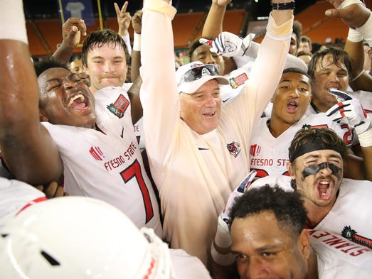 Fresno State Bulldogs head coach Jeff Tedford celebrates
