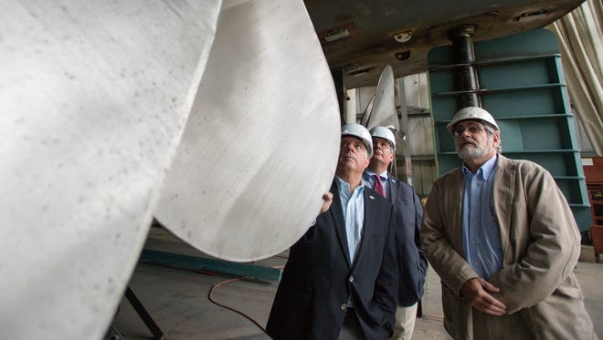 Larry Hogan, then the Republican candidate for Maryland governor, left, toured Chesapeake Shipbuilding in Salisbury with Chesapeake President Tony Severn and State Senate candidate Mike McDermott (rear).