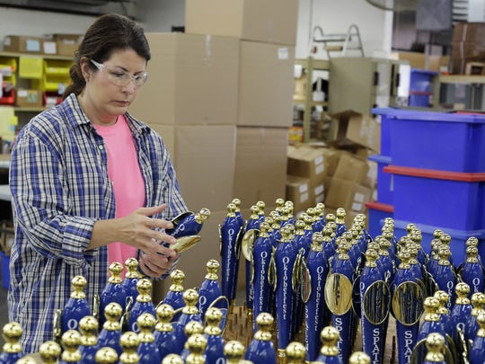 AJS and Associates employee Tamara Theune does a final inspection on tap handles as she prepares them for shipment to a customer Wednesday June 15, 2016 in Random Lake.