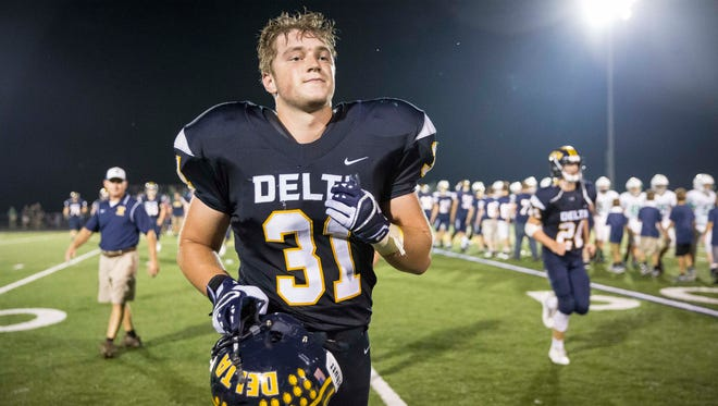 Delta's Mason Hunt runs off the field after beating New Castle in the homecoming game on Sept. 22 at Delta High School.