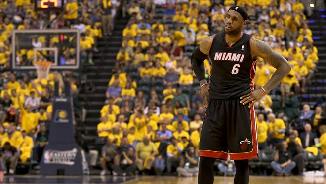 Miami Heat's LeBron James (6) reacts May 28, 2014, after being called for his fourth foul during the second half of Game 5 of the NBA Eastern Conference Finals. The Indiana Pacers beat the Heat 93-90 at Bankers Life Fieldhouse in Indianapolis.