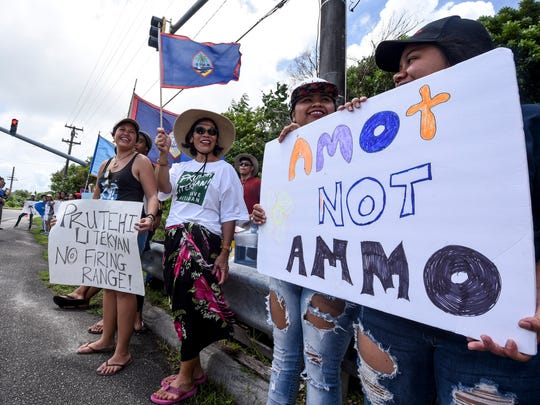 Protesters and others are gathered for a peaceful protest near the main gate of Andersen Air Force Base in Yigo on Saturday, Sept. 23, 2017.