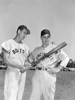 Boston Red Sox batter Ted Williams, left, here chatting with  Cincinnati Reds first baseman Ted Kluszewski, had to contend with the infield shift in his Hall of Fame career.