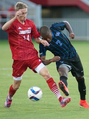 University of Louisville Cardinals midfielder Daniel Johnson and University of Kentucky Wildcats midfielder Napo Matsoso vie for control of the ball.06 Sept 2015