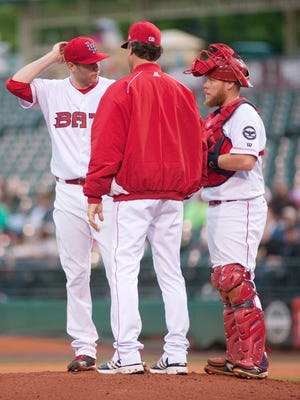 Louisville Bats pitching coach Ted Power tries to calm Bats starting pitcher Jon Moscot as Bats catcher Chris Berset, right, listens in. Moscot, a Reds pitcher rehabbing with the Bats, gave up 9 runs in the first 4 innings, including 7 of those runs from 4 homers.20 May, 2016