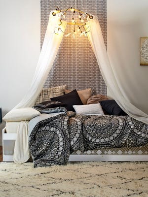 """t's a design dream and a challenge: how to outfit a small, nondescript college dorm room. DwellStudio founder and creative director Christiane Lemieux's tips include creating a chandelier with a hula hoop, duct tape, two curtain panels, a string of lights and washi tape. Instructions are in Lemieux's """"Industrial Bohemian Luxe"""" YouTube tutorial."""