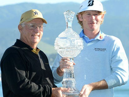 Toby Wilt, left, with Brandt Snedeker, after winning the 2013 Pebble Beach National Pro-Am. Wilt has been been selected for induction into the Tennessee Golf Hall of Fame.