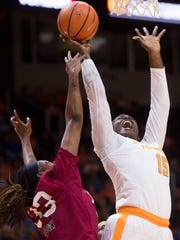 Tennessee forward Cheridene Green (15) takes a shot