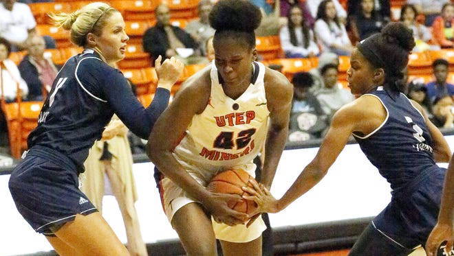 Tamara Seda, center, holds onto the ball while trying to get past Rice defenders Saturday.