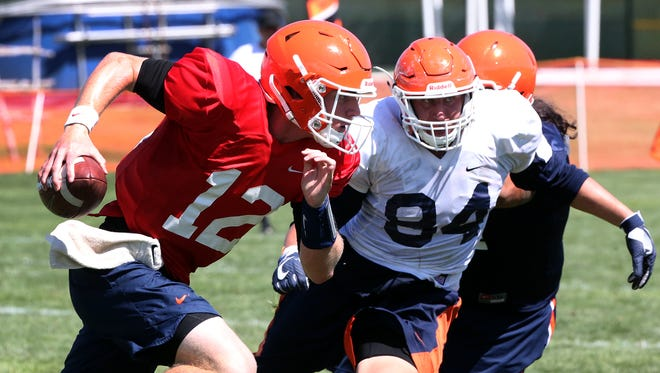UTEP starting quarterback Ryan Metz, 12, scrambles with the ball during Friday's practice at Camp Ruidoso.