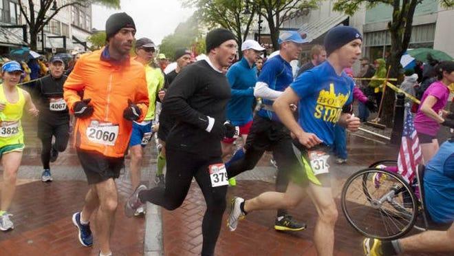 Runners turn form Church Street onto Cherry Street during the KeyBank Vermont City Marathon in Burlington on Sunday, May 26, 2013.