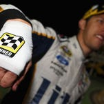 Brad Keselowski's celebration after the 2014 Quaker State 400 led to a sliced hand in Victory Lane.