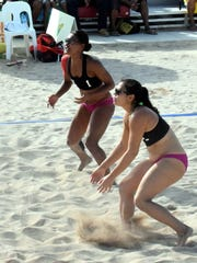 The Guam women's national beach volleyball team of Tatiana Sablan (left) and Kara Guerrero play defense during their match against Tahiti at the Pacific Games in Port Moresby, Papua New Guinea in 2015.
