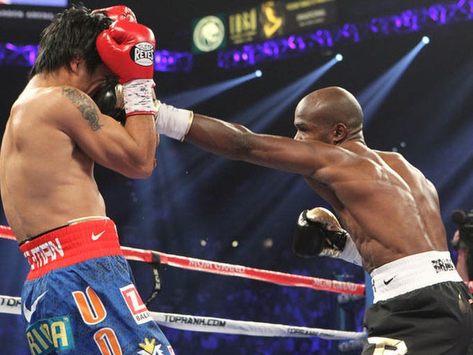 "A sequence of photographs round by round during the WBO Welterweight championship of the world between former title holder Emmanuel ""Manny"" Pacquiao and Timothy Bradley Jr. at the MGM Grand Garden Arena on June 9, 2012.  Omar Ornelas/ The Desert Sun"