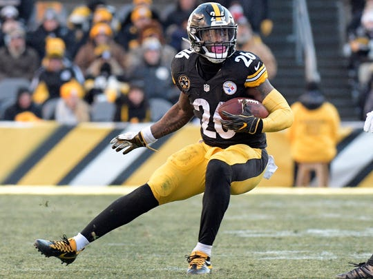 FILE - In this Sunday, Jan. 14, 2018 file photo, Pittsburgh Steelers running back Le'Veon Bell carries the ball against the Jacksonville Jaguars during the second half of an NFL divisional football AFC playoff game in Pittsburgh.