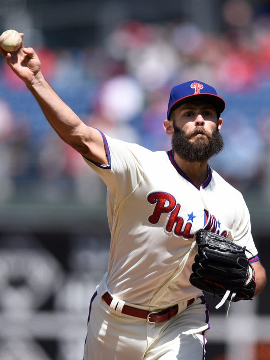 Philadelphia Phillies' Jacob Arrieta throws a pitch during the first inning of a baseball game against the Miami Marlins, Sunday, April 8, 2018, in Philadelphia. (AP Photo/Michael Perez)