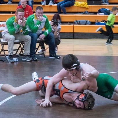Newark Catholic's Richie Stalnaker wrestles with Ridgewood's