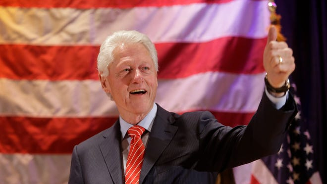 Former president Bill Clinton gestures to a crowd during a rally Thursday, Oct. 30, 2014, in New York. (AP Photo/Frank Franklin II) ORG XMIT: NYFF111